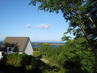 Looking over the cottage to Small Isles Bay